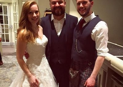 wedding guest with bride and groom